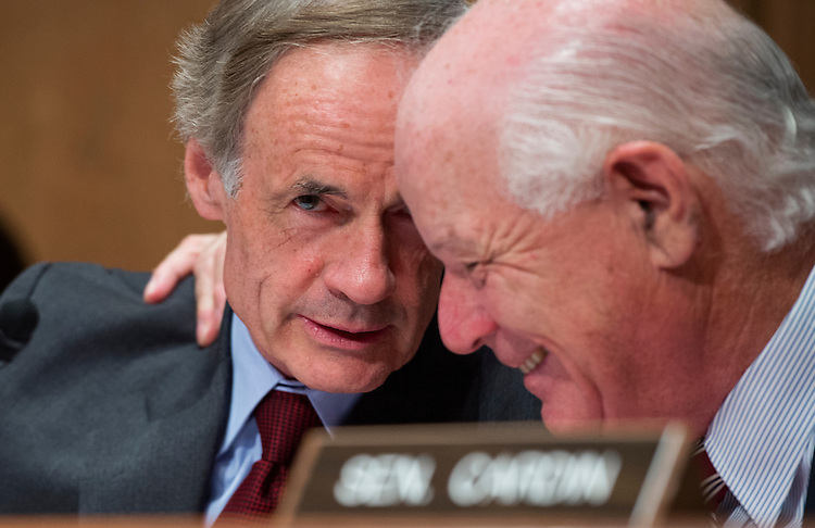"UNITED STATES - SEPTEMBER 25: Sens. Tom Carper, D-Del., left, and Ben Cardin, D-Md., confer during a Senate Environment and Public Works Committee hearing in Dirksen titled ""The Need to Invest in America's Infrastructure and Preserve Federal Transportation Funding."" (Photo By Tom Williams/CQ Roll Call)"