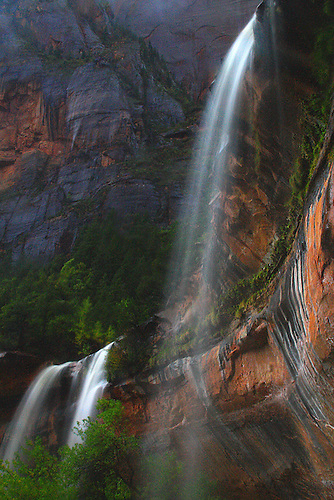 Three waterfalls are produced during a heavy rain at The Emerald Pools at Zion National Park,Utah
