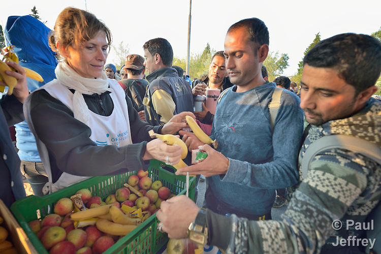 Refugees and migrants receive food and blankets from Anikó Lévai, the wife of Hungarian Prime Minister Viktor Orbán, as she volunteers with Hungarian Interchurch Aid, a member of the ACT Alliance, to provide support to the migrants as they leave the Hungarian town of Hegyeshalom and prepare to cross the border into Austria. Hundreds of thousands of refugees and migrants flowed through Hungary in 2015, on their way to western Europe from Syria, Iraq and other countries.