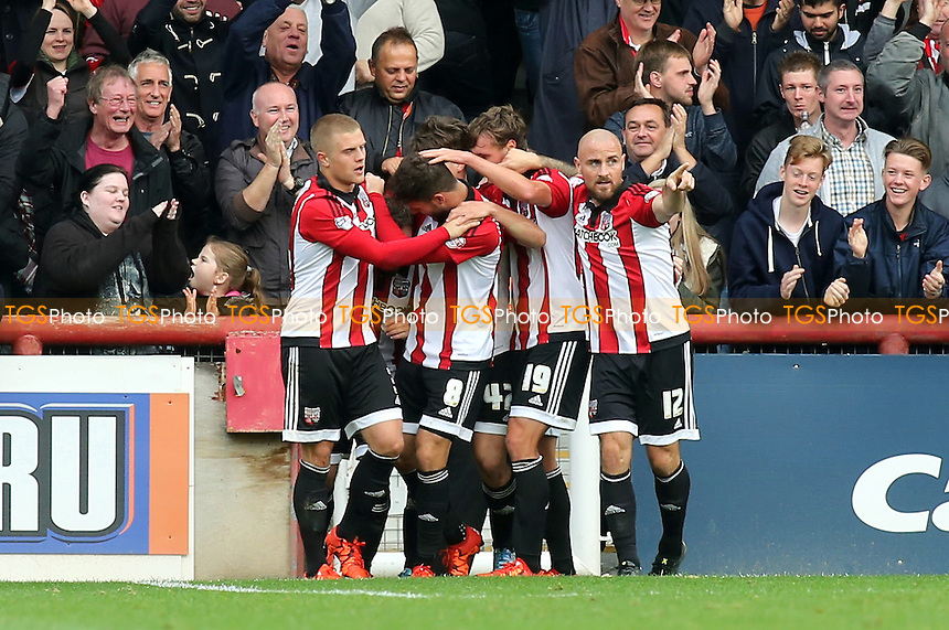 Brentford players congratulate Alan Judge after scoring their second goal during Brentford vs Rotherham United, Sky Bet Championship Football at Griffin Park, London, England on 17/10/2015