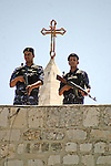 Palestinian security forces stand guard on the roof of the Church of Nativity in Bethlehem's Manger Square during the arrival of the participants in the sixth conference of Fatah movement in the  West Bank city of Bethlehem on Aug 5, 2009. Photo by Najeh Hashlamoun