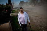 Hortencia Franco walks in the Parklawn neighborhood in Modesto, Calif., as it is street cleaned for the first time in her memory, February 22, 2012.