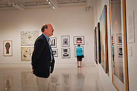 Rich Stevens and Judy Hushon, The von Liebig Art Center Board, walk through the 'Cuba on My Mind' exhibit before the ribbon cutting ceremony, Naples, Florida, USA, March 10, 2011. Photo by Debi Pittman Wilkey