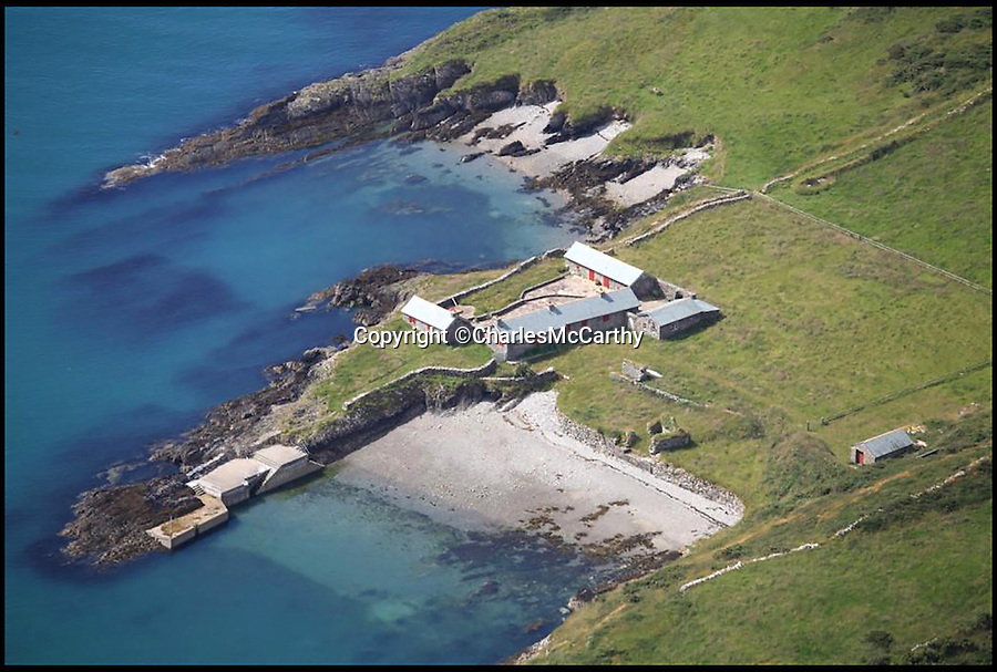 BNPS.co.uk (01202 558833)<br /> Pic: CharlesMcCarthy/BNPS<br /> <br /> An aerial view of the cottages on the island.<br /> <br /> This beautiful Irish island could be the ultimate get away from stressed out city living and comes complete with an old airstrip. <br /> <br /> Whoever stumps up £1.5million for the peaceful 33 acre plot will live in four traditional stone cottages - which have all been recently renovated.  <br /> <br /> And despite sitting 1.5 miles off the South East coast of Ireland its not completely cut off from civilization.