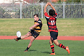 Jordan Goldsmith kicks downfield as Paul Wolfgramm applies pressure. Counties Manukau Premier Club Rugby game between Papakura and Bombay, played at Massey Park Papakura on Saturday June 16th 2018. Bombay won the game 36 - 17 after leading 17 - 7 at halftime.<br /> Papakura Ray White 17 - Kris Smithson 2, Taafaga Tagaloa tries, Monty Punatai conversion.<br /> Bombay 36 - Jordan Goldsmith, Haamiora Clarke 2, Patrick Masoe, Mitchell Thackham, Chay Mackwood tries, Jordan Goldsmith 2, Ki<br /> Anufe conversions.<br /> Photo by Richard Spranger.