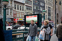 """A subway entrance information display warns of the imminent shutdown of the transit system because of Hurricane Sandy, in New York on Sunday, October 28, 2012. In advance of the arrival of Hurricane Sandy New York will shut down the subways at 7 PM on Sunday and evacuate low lying """"Zone A"""" areas including Battery Park City. In addition the schools will be closed on Monday. (© Frances M. Roberts)"""