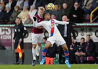 Burnley's Ben Mee clashes heads with Crystal Palace's Jordan Ayew<br /> <br /> Photographer Rich Linley/CameraSport<br /> <br /> The Premier League - Burnley v Crystal Palace - Saturday 30th November 2019 - Turf Moor - Burnley<br /> <br /> World Copyright © 2019 CameraSport. All rights reserved. 43 Linden Ave. Countesthorpe. Leicester. England. LE8 5PG - Tel: +44 (0) 116 277 4147 - admin@camerasport.com - www.camerasport.com
