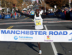 Paul Chelimo (5) hits the finish line with Kirubel Erasse (19) close behind, during the 81st running of the Manchester Road Race, Thursday, November 23, 2017, in  Manchester. (Jim Michaud / Journal Inquirer)