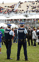Police watch the crowd during Day Three of the Hamilton 400 Aussie V8 Supercars Round Two at Frankton, Hamilton, New Zealand on Sunday, 19 April 2009. Photo: Dave Lintott / lintottphoto.co.nz
