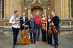 Michael Morpurgo, author of War Horse, with actress  Alison Reid, violinist Daniel Pioro and a string quartet in front of the Divinity School during the FT Weekend Oxford Literary Festival, Oxford, UK. Sunday 30 March 2014.<br /> <br /> PHOTO COPYRIGHT Graham Harrison<br /> graham@grahamharrison.com<br /> <br /> Moral rights asserted.