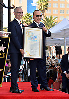 LOS ANGELES, CA. October 10, 2019: Tommy Mottola & Mitch O'Farrell at the Hollywood Walk of Fame Star Ceremony honoring Tommy Mottola.<br /> Pictures: Paul Smith/Featureflash