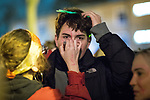 © Joel Goodman - 07973 332324 . 22/02/2018 . Manchester , UK . A woman paints a man's face . 100s of protesters , campaigning against the sexual harassment, abuse, rape and victim-blaming suffered by women, hold a Reclaim the Night march and rally from Owens Park in Fallowfield to the Manchester Academy on Oxford Road . Photo credit : Joel Goodman