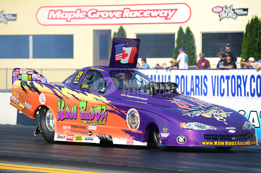 Oct. 5, 2012; Mohnton, PA, USA: NHRA top alcohol funny car driver Cassie Simonton during qualifying for the Auto Plus Nationals at Maple Grove Raceway. Mandatory Credit: Mark J. Rebilas-