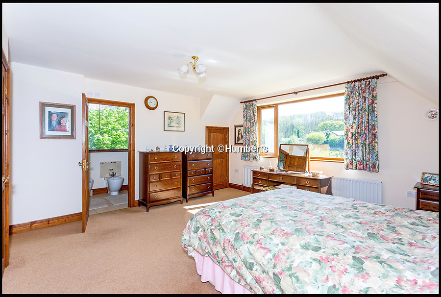 BNPS.co.uk (01202 558833)<br /> Pic: Humberts/BNPS<br /> <br /> The house has five bedrooms...<br /> <br /> Gimme Shelter - a quaint country bolt hole where the Rolling Stones stayed while playing gigs in the west country has emerged for sale. <br /> <br /> 'Pasaderas', which coincidentally means 'stepping stones' in Spanish, played host to the raucous band a number of times throughout the 1960s. <br /> <br /> The unsuspecting five bedroom home sits in secluded Gloucestershire countryside - thus providing the megastars with privacy away from pestering paparazzi and adoring fans. <br /> <br /> In those days the house belonged to a close friend of the late Stones co-founder and guitarist Brian Jones called Kerry Hamer, both of whom were from Cheltenham.