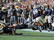Annapolis, MD - October 21, 2017: \UCF Knights defensive back Mike Hughes (19) tackles Navy Midshipmen running back Darryl Bonner (29) during the game between UCF and Navy at  Navy-Marine Corps Memorial Stadium in Annapolis, MD.   (Photo by Elliott Brown/Media Images International)