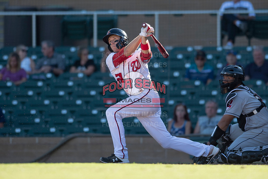 Salt River Rafters second baseman Carter Kieboom (24), of the Washington Nationals organization, follows through on his swing in front of catcher Li-Jen Chu (2) during an Arizona Fall League game against the Glendale Desert Dogs at Salt River Fields at Talking Stick on October 31, 2018 in Scottsdale, Arizona. Glendale defeated Salt River 12-6 in extra innings. (Zachary Lucy/Four Seam Images)