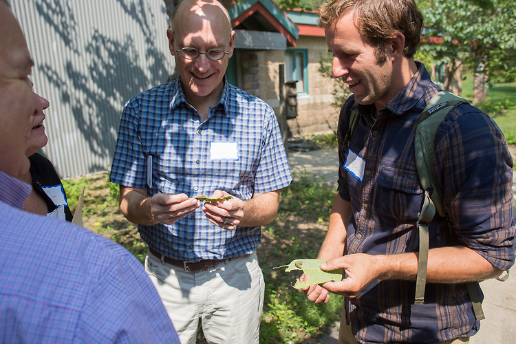 Bob Frank, left, the dean of the College of Arts and Sciences, and Joe Brehm, the Environmental Education Program Director at Rural Action, look at caterpillars they found at the Wayne National Forest Headquarters during The Faculty/President Nellis Fall Orientation Tour on Sept. 10, 2017.