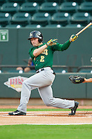 Matt Lipka (2) of the Lynchburg Hillcats follows through on his swing against the Winston-Salem Dash at BB&T Ballpark on August 5, 2013 in Winston-Salem, North Carolina.  The Dash defeated the Hillcats 5-0.  (Brian Westerholt/Four Seam Images)