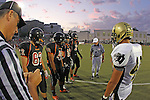 Beverly Hills, CA 09/23/11 - Madison Moore (Beverly Hills #49), Willie Green (Beverly Hills #2), Ezra Laemmle (Beverly Hills #19) and Eric Simsolo (Beverly Hills #62) in action during the Peninsula-Beverly Hills Varsity football game.