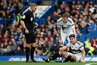 Tom Cairney of Fulham lies injured on the ground awaiting treatment during Chelsea vs Fulham, Premier League Football at Stamford Bridge on 2nd December 2018