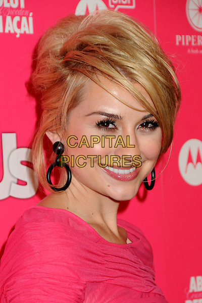 CHELSEA STAUB.US Weekly Hot Hollywood Style Issue Event held at Drai's at the W Hollywood Hotel, Hollywood, California, USA..April 22nd, 2010.headshot portrait black hoop earrings sweeping fringe pink coral .CAP/ADM/BP.©Byron Purvis/AdMedia/Capital Pictures.