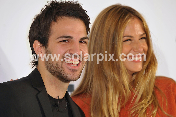 **ALL ROUND PICTURES FROM SOLARPIX.COM**                                             **WORLDWIDE SYNDICATION RIGHTS EXCEPT SPAIN - NO SYNDICATION IN SPAIN**                                                                                  Caption: Martina Klein and Cesc Fabregas at a photocall to launch the new Angel Schlesser fragrance in Madrid, Spain. 15 June 2011                                                                               This pic: Martina Klein and Cesc Fabregas                                                                                             JOB REF: 13563 DMS Jesus      DATE: 15_06_2011                                                           **MUST CREDIT SOLARPIX.COM OR DOUBLE FEE WILL BE CHARGED**                                                                      **MUST AGREE FEE BEFORE ONLINE USAGE**                               **CALL US ON: +34 952 811 768 or LOW RATE FROM UK 0844 617 7637**