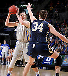 SIOUX FALLS, SD - MARCH 9: Clarissa Ober #21 of SDSU looks to pass against defender Vicky McIntyre #34 of Oral Roberts in the first half of their semi-final round Summit League Championship Tournament game Monday afternoon at the Denny Sanford Premier Center in Sioux Falls, SD. (Photo by Dick Carlson/Inertia)