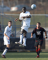 University of Connecticut forward Mamadou Doudou Diouf (23) heads the ball. .NCAA Tournament. University of Connecticut (white) defeated Northeastern University (black), 1-0, at Morrone Stadium at University of Connecticut on November 18, 2012.