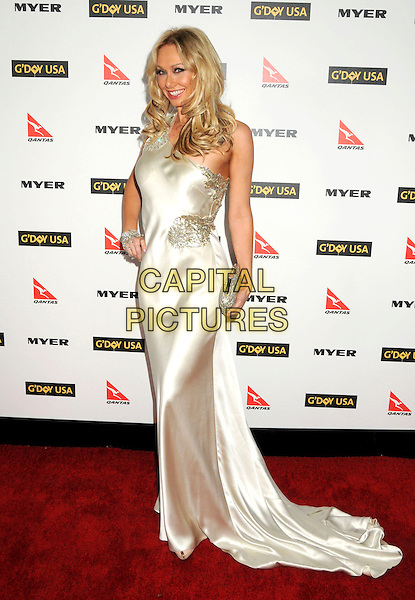 KYM JOHNSON.Attending the 2010 G'Day USA Australia Week Black Tie Gala held at the Hollywood & Highland Grand Ballroom, Hollywood, California, USA, .16th January 2010..arrivals full length gold dress silk satin long maxi one shoulder train clutch bag hand on hip bracelet cuff .CAP/ADM/BP.©Byron Purvis/Admedia/Capital Pictures