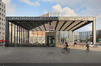 Entrance to the Bahnhof or train station on Potsdamer Platz, with people riding bikes, Berlin, Germany. Picture by Manuel Cohen