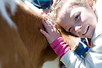 Adra Parrish, 6, of Fremont Elementary School in Carson City, Nev., participates in the cow plop fundraiser, where she was able to meet Buttercup, a Holstein Ayrshire mix.<br />