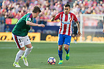 Miguel Olavide of Club Atletico Osasuna competes for the ball with Angel Correa of Atletico de Madrid during the match of La Liga between  Atletico de Madrid and Club Atletico Osasuna at Vicente Calderon  Stadium  in Madrid, Spain. April 15, 2017. (ALTERPHOTOS / Rodrigo Jimenez)