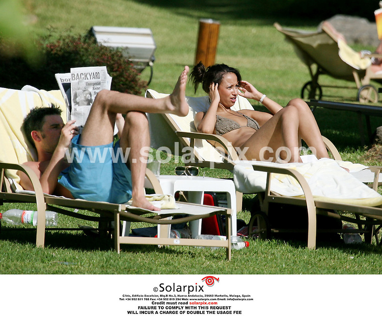 ALL ROUND EXCLUSIVE PICTURES BY SOLARPIX.COM..**MUST CREDIT SOLARPIX.COM OR DOUBLE FEE INCURRED**.Girl Band The Sugarbabes relaxing under the Spanish sun at their Hotel on the afternoon before their concert in Marbella Spain during their European tour..This Pic shows:New Band member Amelle Berrabah and Heidi´s TV Presenter boyfriend Dave Berry..Job Ref.AB1 2708 12.8.06