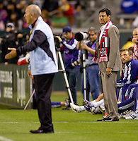 CD Chivas USA head coach Martin Vasquez (suit & slacks) looks over at Houston Dynamo head coach Dominic Kinnear (sweat suit) on the sideline. The Houston Dynamo defeated CD Chivas USA 2-0 at Home Depot Center stadium in Carson, California on Saturday May 8, 2010.  .