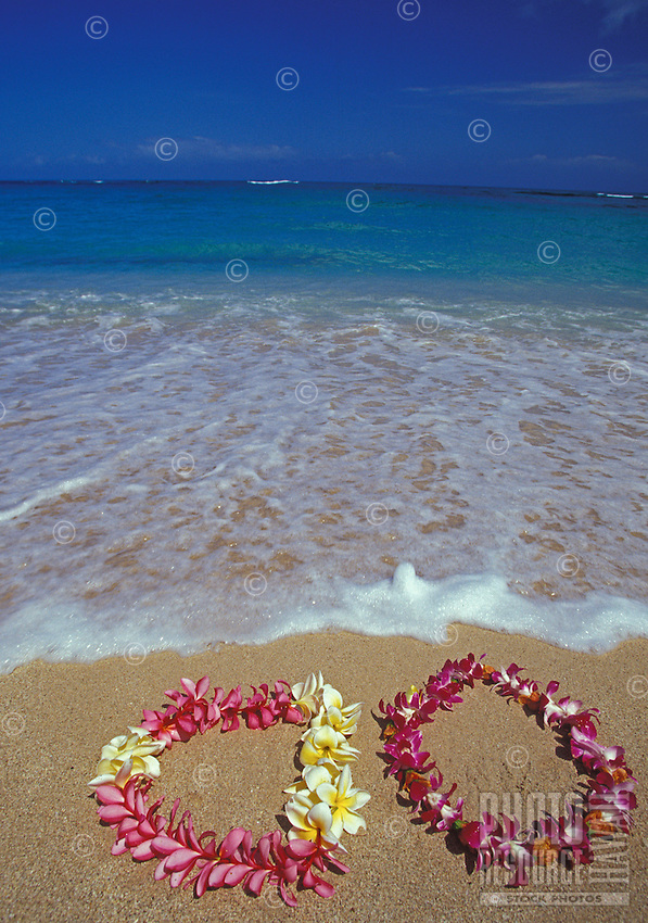 Plumeria leis, a beautiful and fragrant Hawaiian tradition. at the beach