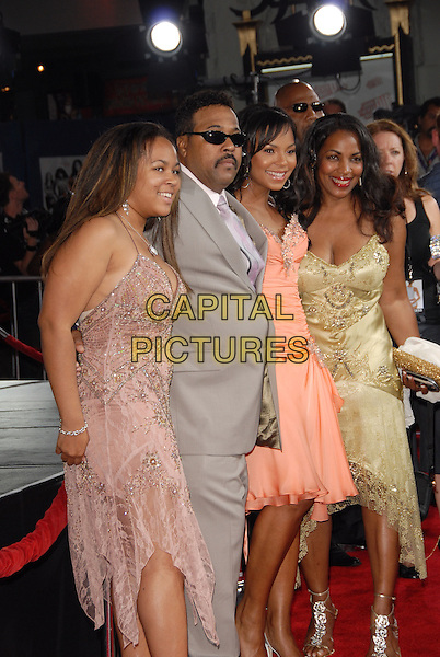 "ASHANTI & FAMILY.Los Angeles Premiere of ""John Tucker Must Die"" held at The Grauman's Chinese Theatre in Hollywood, California  .July 25th, 2006.Ref: DVS.half length lilac grey gray coral peach pink green dress.www.capitalpictures.com.sales@capitalpictures.com.©Debbie VanStory/Capital Pictures"
