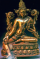"""India: Avalokitesvara--12th C. bronze, 10"""" high. Chandra doesn't say who this divinity is. Figure sits on lotus pedestal, and between lotus plants.  A diadem--not visible- in form of Buddha. Note vertical third eye."""
