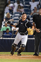 Tampa Yankees catcher Kyle Higashioka (25) looks for a pop up during a game against the Daytona Tortugas on April 24, 2015 at George M. Steinbrenner Field in Tampa, Florida.  Tampa defeated Daytona 12-7.  (Mike Janes/Four Seam Images)