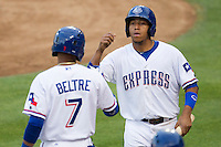 Round Rock outfielder Yangervis Solarte (26) is greeted by teammate Engel Beltre (7) after scoring in the Pacific Coast League baseball game against the Nashville Sounds on May 4, 2013 at the Dell Diamond in Round Rock, Texas. Round Rock defeated Nashville -6. (Andrew Woolley/Four Seam Images).