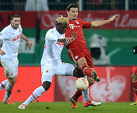 FUSSBALL  DFB-POKAL  ACHTELFINALE  SAISON 2012/2013    FC Augsburg - FC Bayern Muenchen        18.12.2012 Aristide Bance (li, FC Augsburg) gegen Daniel van Buyten (FC Bayern Muenchen)