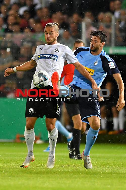 09.08.2019, BWT-Stadion am Hardtwald, Sandhausen, GER, DFB Pokal, 1. Runde, SV Sandhausen vs. Borussia Moenchengladbach, <br /><br />DFL REGULATIONS PROHIBIT ANY USE OF PHOTOGRAPHS AS IMAGE SEQUENCES AND/OR QUASI-VIDEO.<br /><br />im Bild: Rurik Gislason  (#9, SV Sandhausen) gegen Tobias Strobl (#5, Borussia Moenchengladbach)<br /><br />Foto © nordphoto / Fabisch