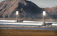 Solar Boilers and Heliostats at Ivanpah Solar Power Facility. This $2.2 billion project in the Mojave Desert 40 milies southwest of Las Vegas is the world's largest solar thermal power plant. The project began operation in February 2014. It uses 173,500 heliostats, each with two mirrors, to focus solar energy on boilers located on three towers. The boilers. which glow like mini-suns, convert water to steam. The steam  drives conventional turbines. San Bernardino Co., Calif.