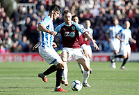 Huddersfield Town's Christopher Schindler under pressure from Burnley's Ashley Barnes<br /> <br /> Photographer Rich Linley/CameraSport<br /> <br /> The Premier League - Burnley v Huddersfield Town - Saturday 6th October 2018 - Turf Moor - Burnley<br /> <br /> World Copyright &copy; 2018 CameraSport. All rights reserved. 43 Linden Ave. Countesthorpe. Leicester. England. LE8 5PG - Tel: +44 (0) 116 277 4147 - admin@camerasport.com - www.camerasport.com