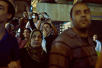 EGYPT / Cairo / 27.11.2012 / People look at protesters during a march from the Shubra neighbourhood to Tahrir square, where thousands of people have gathered to protest President Morsi's above-the-law constitutional declaration. <br /> <br /> &copy; Giulia Marchi