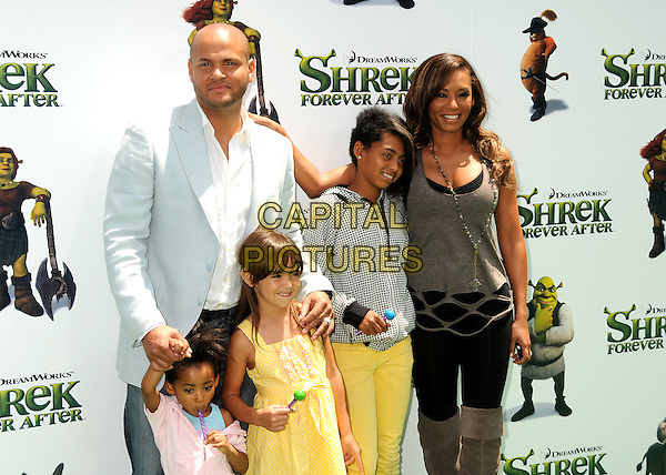 "STEPHEN BELAFONTE, MELANIE BROWN (MEL B) with children ANGEL, guest & PHOENIX CHI.Attending the ""Shrek Forever After"" Los Angeles Film Premiere held at the Gibson Amphitheatre, Universal City, California, USA, 16th May 2010..arrivals half length  grey gray vest top ripped holes cut out  black leggings suede otk over the knee high boots necklace daughters daughter married couple family husband wife .CAP/ADM/BP.©Byron Purvis/AdMedia/Capital Pictures."