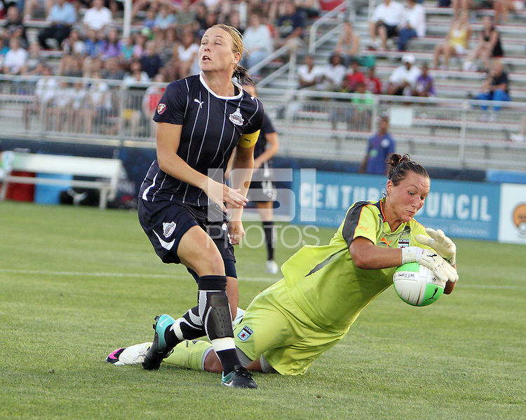 Abby Wambach #20 of the Washington Freedom loses the ball to Jillian Loyden #1 of the Chicago Red Stars during a WPS match at Maryland Soccerplex on August 19 2010, in Boyds, Maryland. Freedom won 2-0.