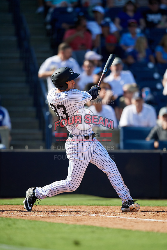 New York Yankees left fielder Zach Zehner (93) follows through on a swing during a Grapefruit League Spring Training game against the Toronto Blue Jays on February 25, 2019 at George M. Steinbrenner Field in Tampa, Florida.  Yankees defeated the Blue Jays 3-0.  (Mike Janes/Four Seam Images)