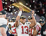 Alabama Crimson Tide quarterback Tua Tagovailoa (13) hoists the National Championship trophy after defeating the Georgia Bulldogs 26-23 in the NCAA College Football Playoff National Championship at Mercedes-Benz Stadium on January 8, 2018 in Atlanta. Photo by Mark Wallheiser/UPI
