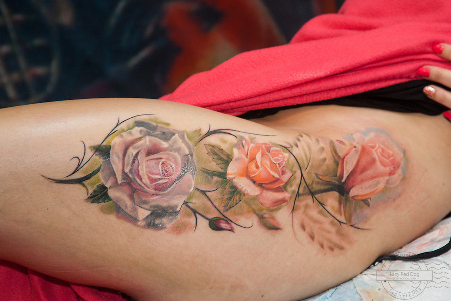 Tattoo. Snapshots from Copenhagen Ink Festival 2013. Roses on leg and hip done by Mornel from Artistico.