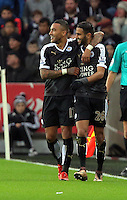 Riyad Mahrez of Leicester City (R) with Danny Simpson (L) celebrates his second goal during the Barclays Premier League match between Swansea City and Leicester City at the Liberty Stadium, Swansea on December 05 2015